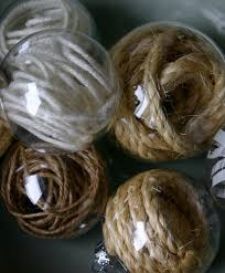 clear glass ornaments filled with twine i love these to bad they