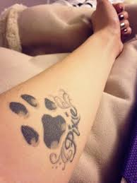 dog paw tattoo in memory of my dog