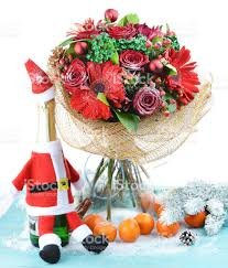 flowers and fruit christmas bouquet of fresh flowers and fruit and a bottle stock