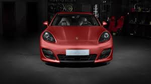 red porsche panamera porsche panamera turbo receives striking red aluminum wrap from