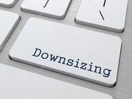 white keyboard with downsizing button u2014 stock photo