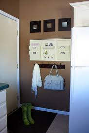 wall mounted magazine rack in laundry room contemporary with wall