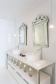 Venetian Mirror Bathroom by Gorgeous White Bathroom Features Matching Side By Side Venetian