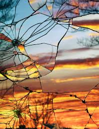 photographs of sunsets as reflected through shattered mirrors by