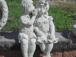 whispering boy and garden statues garden