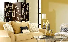 ideas beige sofa with decorative cushions and glass coffee table