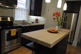 black kitchen cabinets with butcher block countertops kitchen