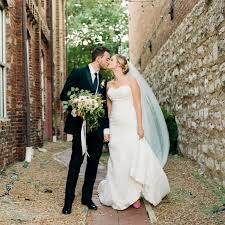 wedding in a greenery filled warehouse wedding in nashville brides