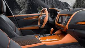 maserati levante interior back seat mansory tuned a maserati levante and the result is very orange