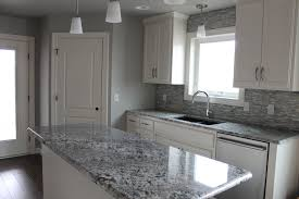 what color granite with white cabinets and dark wood floors lighting light gray granite countertops with cherry cabinets