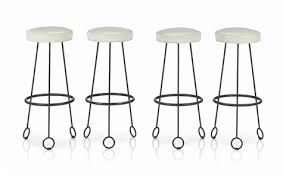 jean royere yo yo table a set of four yo yo bar stools 1950s by jean royère on artnet