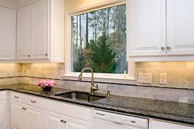 blue pearl granite with white cabinets classic white perfectly balanced by creams and blues traditional