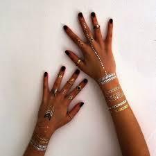 new trend alert for tattoos lovers the metallic ink vanguard allure