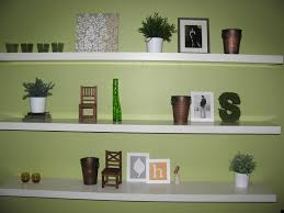 floating white wooden shelves for pictures and ornaments