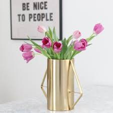 an easy trick to arrange short flowers in a tall vase in your home