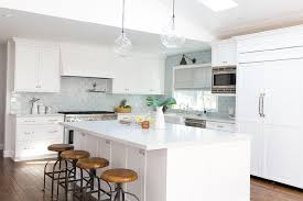 White Kitchen Cabinets With Glaze by White Shaker Kitchen Cabinets With Blue Glazed Subway Tile