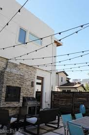 how to string cafe lights outdoor style how to hang commercial grade string lights patio