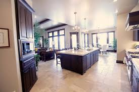 large open floor kitchen with brown cabinets and