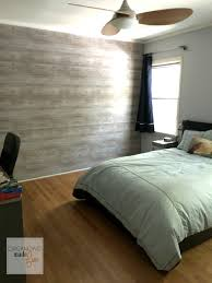 how to fake a plank wall teen boys room update organizing made fake planked wall with wallpaper in a teen boy s room organizingmadefun com