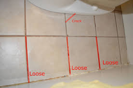 how should i repair these loose tiles in the bathroom