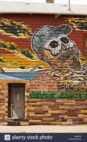 illinois chicago mural on side of house in pilsen neighborhood on illinois chicago mural on side of house in pilsen neighborhood on near south side man lying back flames barbed wire