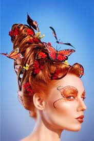 butterfly hair beehive hair style with painted butterflies wired into the