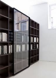 Wall Bookcase With Doors Livingroom Bookcase With Sliding Doors Furniture On The Web