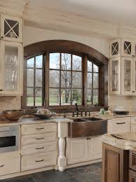 white kitchen with distressed cabinets distressed kitchen cabinetry and copper sink beck allen