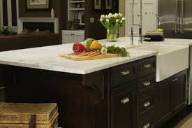 traditional dark wood kitchen island with farmhouse sink
