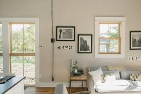 fixer upper season 3 episode 14 the shotgun house the living space is the first area you walk into we installed wood floors and beautiful floor length windows this space didn t feel cramped in the least