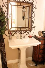 bathroom upgrade ideas a rustic lamp iron mirror paired with a pedestal sink and chrome
