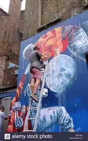 c8 alamy com comp edty8h man on a ladder painting