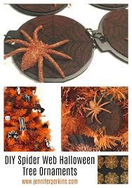 easy stenciled felt spider web ornaments for halloween by jennifer