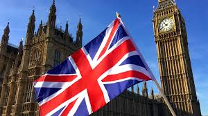 The England Flag Great British Union Jack Flag Flying In Front Of Big Ben And The