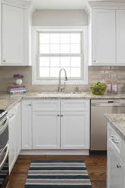 white kitchen cabinets brown countertops brown granite countertops transitional kitchen