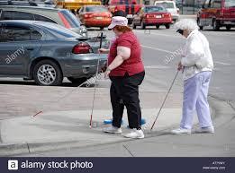 Blind People Canes Group Of Blind People Cross The Street Using Canes Stock Photo
