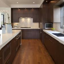 simple kitchen design dark floors thumbing the pages of home
