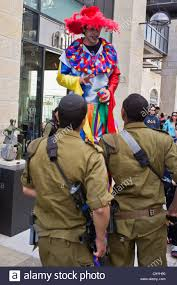 clown stilts for sale two idf soldiers look up to a clown on stilts on purim celebrated