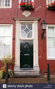 House Front Door Old Red House Front Door With Lamppost In Edam Noord Holland The