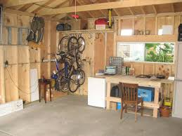 simple low cost diy garage organization ideas with wood wall and simple low cost diy garage organization ideas with wood wall and ceiling beams plus concrete floor tiles and mounted bike hooks storage in the corner under