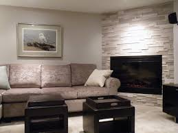corner fireplace in renovated basement featuring erthcoverings