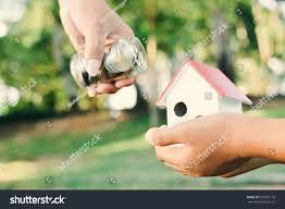 close hand giving money bokeh background stock photo 697851178