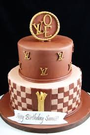 a colorful louis vuitton inspired birthday cake with gold sequins
