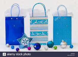 blue gift bags three blue gift bags with tissue paper and snowflake shaped