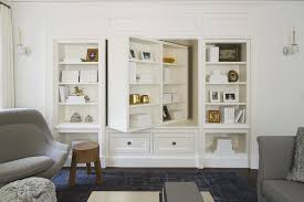 built in living room cabinets pivoting bookcase and tv cabinet transitional living room