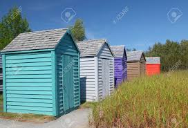 a row of brightly colored small garden sheds stock photo picture
