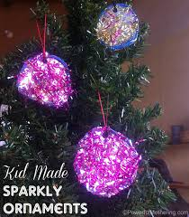 kid made sparkly tinsel ornamanets