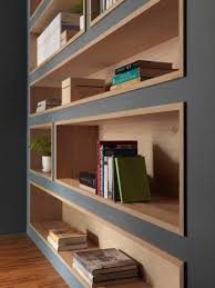 built in bookshelves lined with wood highlight the displayed decor
