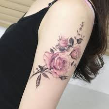 picture of super bold rose foot tattoo