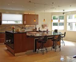 cherry cabinets pendant lights bi level island designer